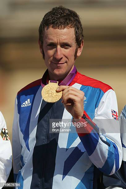 Gold medallist Bradley Wiggins of Great Britain celebrate during the victory ceremony after the Men's Individual Time Trial Road Cycling on day 5 of...