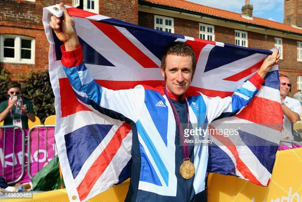 Gold medallist Bradley Wiggins of Great Britain celebrates after the victory ceremony after the Men's Individual Time Trial Road Cycling on day 5 of...