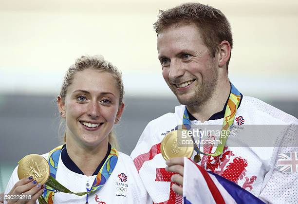 TOPSHOT Gold medallist Britain's Jason Kenny poses next to Women's Omnium gold medallist and fiancee Britain's Laura Trott on the podium after the...