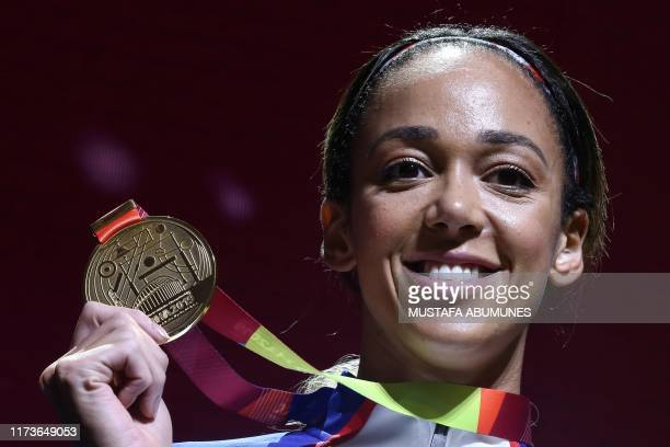 Gold medallist Britain's Katarina JohnsonThompson poses on the podium during the medal ceremony for the Women's Heptathlon at the 2019 IAAF World...