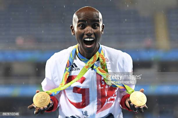 TOPSHOT Gold medallist Britain's Mo Farah celebrates near the podium for the Men's 5000m during the athletics event at the Rio 2016 Olympic Games at...