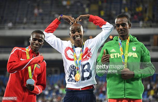 TOPSHOT Gold medallist Britain's Mo Farah poses with silver medallist Kenya's Paul Kipngetich Tanui and bronze medallist Ethiopia's Tamirat Tola on...