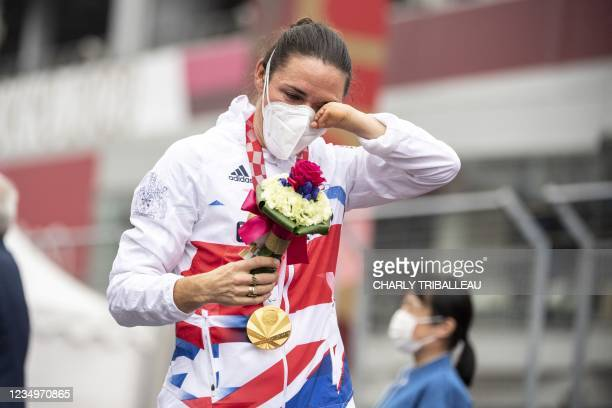 Gold medallist Britain's Sarah Storey celebrates after winning the women's cycling road individual C5 time trial during the Tokyo 2020 Paralympic...