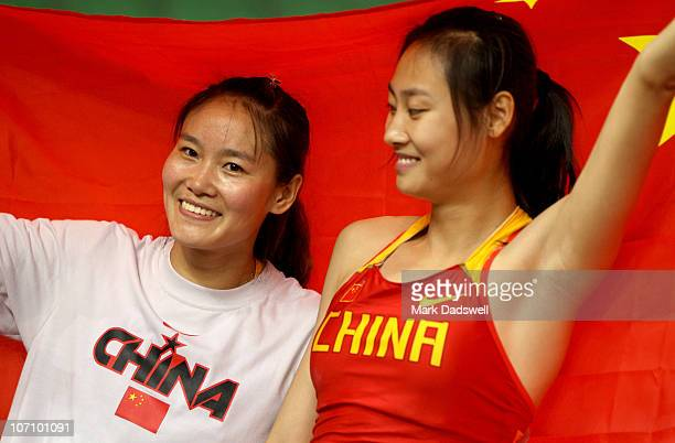 Gold medallist Caixia Li of China and Silver medallist Ling Li of China in the Women's Pole Vault Final at Aoti Main Stadium during day twelve of the...