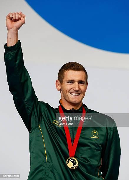 Gold medallist Cameron van der Burgh of South Africa celebrates during the medal ceremony for the Men's 50m Breaststroke Final at Tollcross...