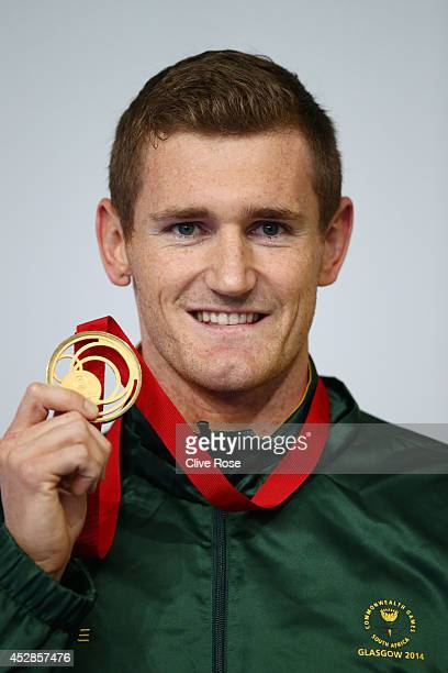 Gold medallist Cameron van der Burgh of South Africa poses during the medal ceremony for the Men's 50m Breaststroke Final at Tollcross International...