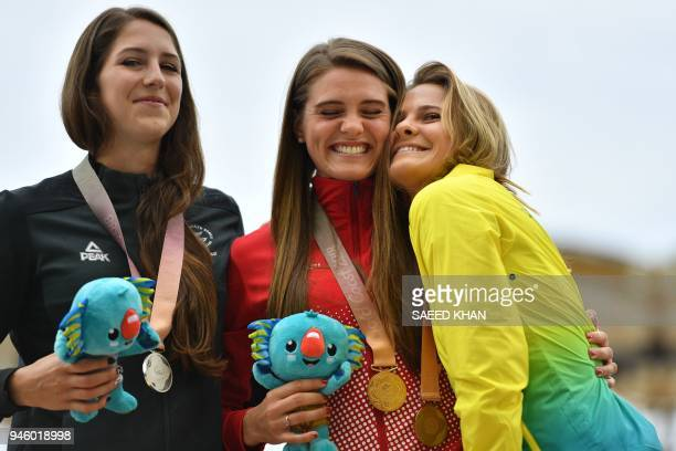 Gold medallist Canadas Alysha Newman poses with silver medallist New Zealands Eliza McCartney and bronze medallist Australias Nina Kennedy during the...