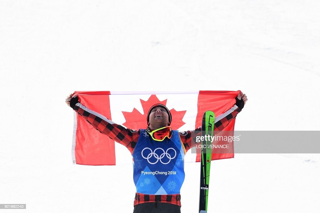 TOPSHOT - Gold medallist Canada's Brady Leman celebrates during the victory ceremony after the men's ski cross big final during the Pyeongchang 2018 Winter Olympic Games at the Phoenix Park in Pyeongchang on February 21, 2018. /