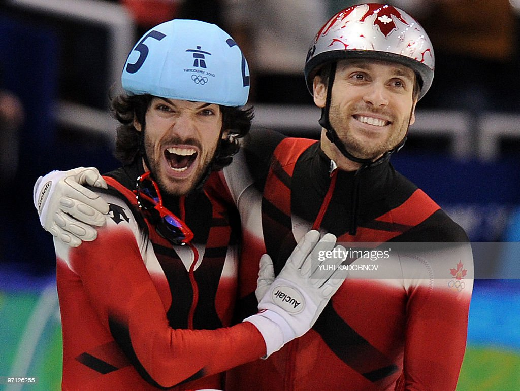 Gold medallist, Canada's Charles Hamelin (L) celebrates with compatriot, bronze medallist Francois-Louis Tremblay at the end of the Men's 500 m short-track final at the Pacific Coliseum in Vancouver, during the 2010 Winter Olympics on February 26, 2010.