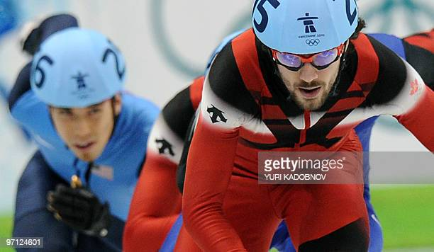 Gold medallist Canada's Charles Hamelin competes disqualified US' Apolo Anton Ohno in the Men's 500 m shorttrack final at the Pacific Coliseum in...