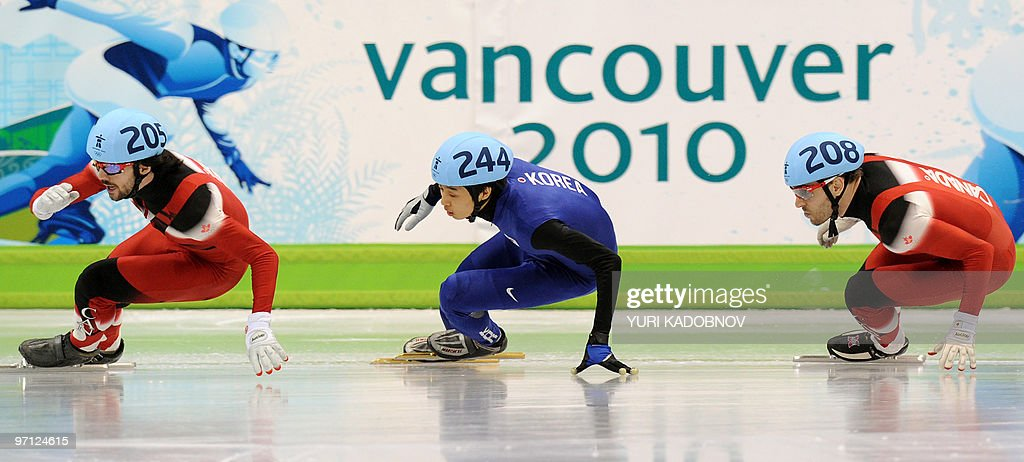 Gold medallist, Canada's Charles Hamelin (L), competes with silver medallist, South Korea's Si-Bak Sung (C) and bronze medallist, Canada's Francois-Louis Tremblay in the Men's 500 m short-track final at the Pacific Coliseum in Vancouver, during the 2010 Winter Olympics on February 26, 2010.
