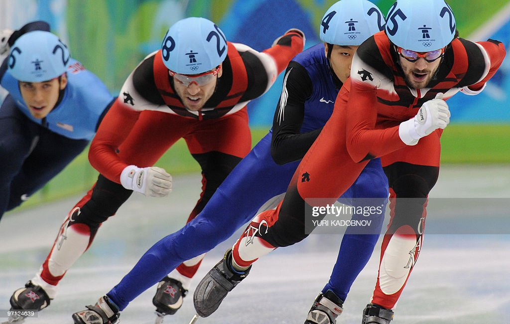 Gold medallist, Canada's Charles Hamelin (R), competes with silver medallist, South Korea's Si-Bak Sung (C) and bronze medallist, Canada's Francois-Louis Tremblay (2nd L) and disqualified US' Apolo Anton Ohno (L) in the Men's 500 m short-track final at the Pacific Coliseum in Vancouver, during the 2010 Winter Olympics on February 26, 2010.