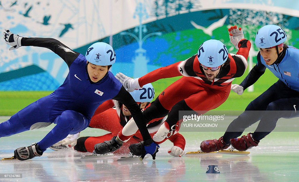 Gold medallist, Canada's Charles Hamelin (C), competes with silver medallist, South Korea's Si-Bak Sung (L) and bronze medallist, Canada's Francois-Louis Tremblay (2ndL down) and disqualified US' Apolo Anton Ohno (R) in the Men's 500 m short-track final at the Pacific Coliseum in Vancouver, during the 2010 Winter Olympics on February 26, 2010.