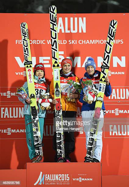 Gold medallist Carina Vogt of Germany poses with silver medallist Yuki Ito of Japan and bronze medallist Daniela IraschkoStolz of Austria after the...