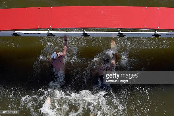 Gold medallist Chad Ho of South Africa looks across after finishing ahead of silver medallist Rob Muffels of Germany during the Men's 5km Open Water...