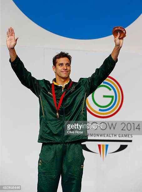 Gold medallist Chad le Clos of South Africa celebrates during the medal ceremony for the Men's 100m Butterfly Final at Tollcross International...