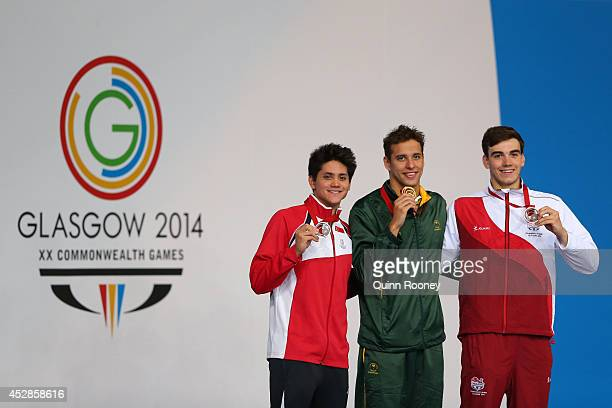 Gold medallist Chad le Clos of South Africa poses with silver medallist Joseph Schooling of Singapore and bronze medallist Adam Barrett of England...