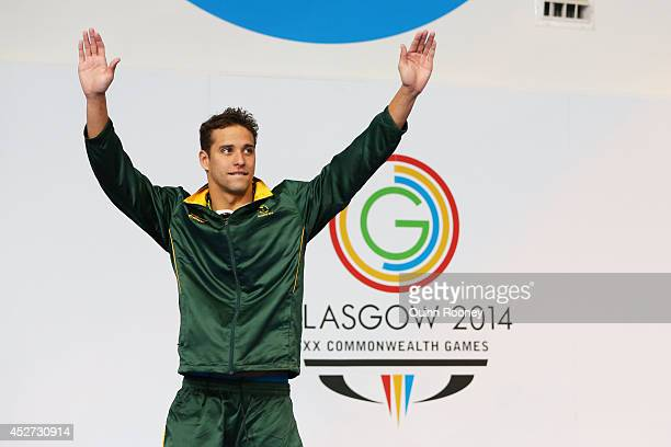 Gold medallist Chad le Clos of South Africa stands on the podium during the medal ceremony for the Men's 200m Butterfly Final at Tollcross...