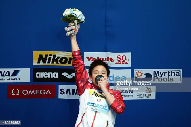 Gold medallist Chao He of China celebrates during the medal ceremony in the Men's 3m Springboard Diving Final on day seven of the 16th FINA World...