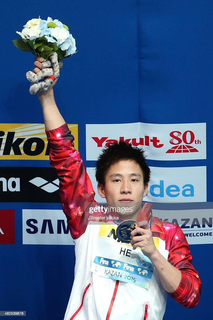 Gold medallist Chao He of China celebrates during the medal ceremony in the Men's 3m Springboard Diving Final on day seven of the 16th FINA World Championships at the Aquatics Palace on July 31, 2015 in Kazan, Russia.
