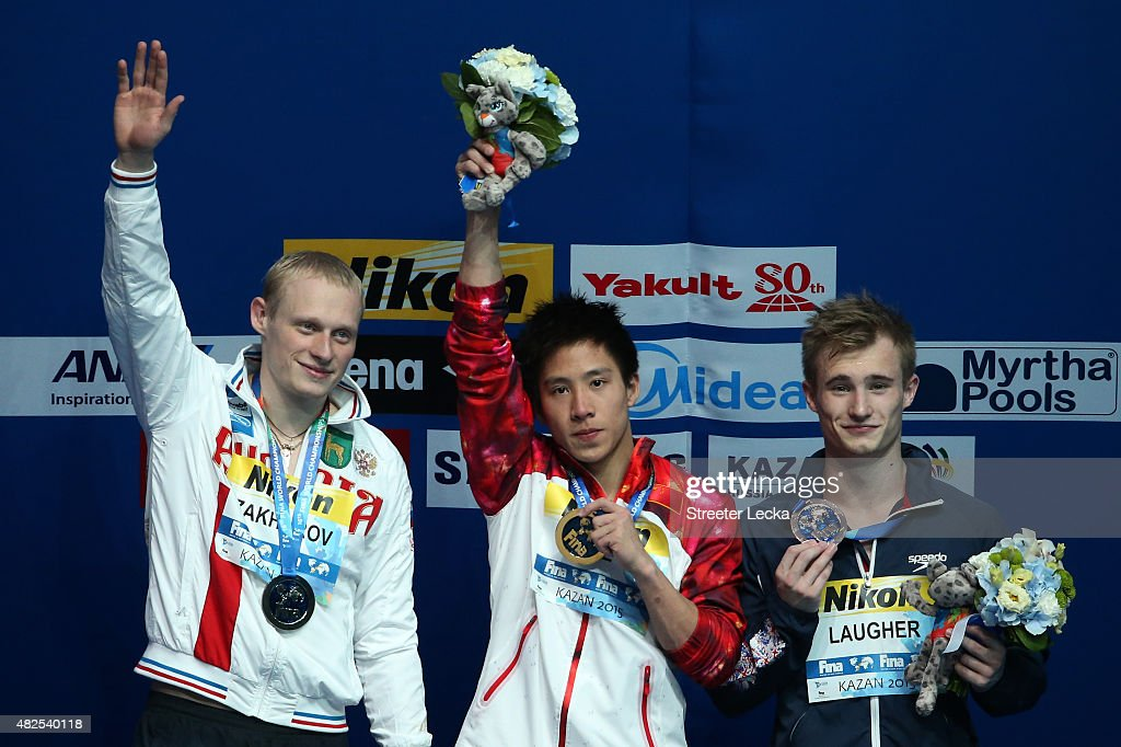 Gold medallist Chao He of China celebrates with silver medallist Ilia Zakharov of Russia and bronze medallist Jack David Laugher of Great Britain during the medal ceremony in the Men's 3m Springboard Diving Final on day seven of the 16th FINA World Championships at the Aquatics Palace on July 31, 2015 in Kazan, Russia.