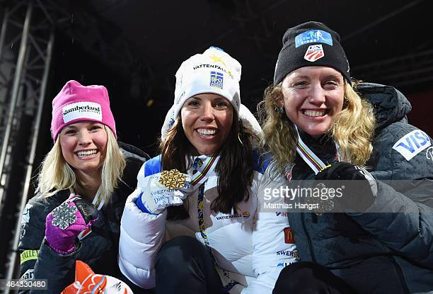 Gold medallist Charlotte Kalla of Sweden poses with silver medallist Jessica Diggins of USA and bronze medallist Caitlin Gregg of USA during the...