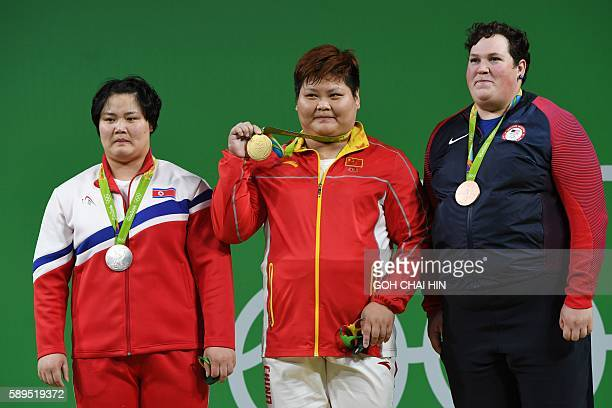 Gold medallist China's Meng Suping silver medallist North Korea's Kim Kuk Hyang and bronze medallist USA's Sarah Elizabeth Robles pose during the...