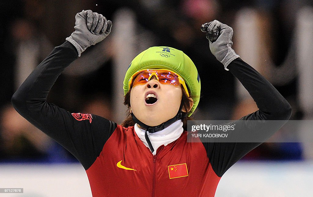Gold medallist, China's Meng Wang celebrates at the end of the Ladies' 1000 m short-track final at the Pacific Coliseum in Vancouver, during the 2010 Winter Olympics on February 26, 2010.
