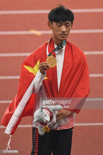 Gold medallist China's Wang Kaihua celebrates during the victory ceremony for the men's 20km race walk athletics event during the 2018 Asian Games in...
