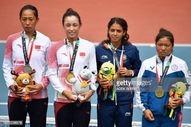 Gold medallist China's Wang Qiang poses with silver medallist China's Zhang Shuai and bronze medallists India's Ankita Ravinderkrishan Raina and...