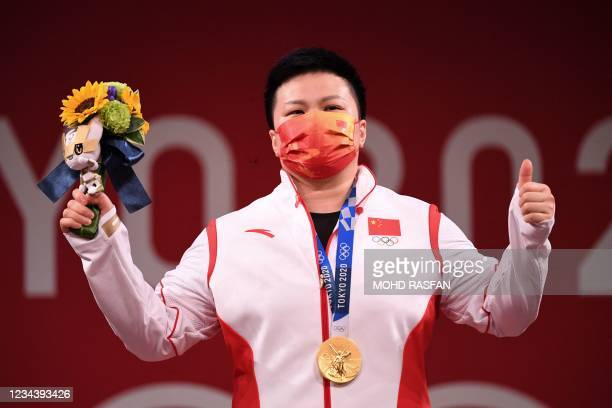 Gold medallist China's Wang Zhouyu poses during the medal ceremony of the women's 87kg weightlifting competition during the Tokyo 2020 Olympic Games...