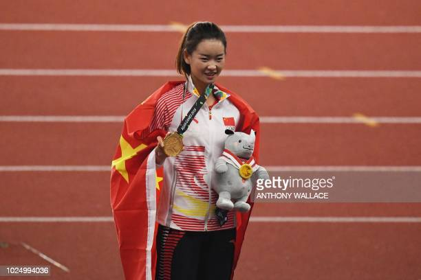 Gold medallist China's Yang Jiayu celebrates during the victory ceremony for the women's 20km race walk athletics event during the 2018 Asian Games...