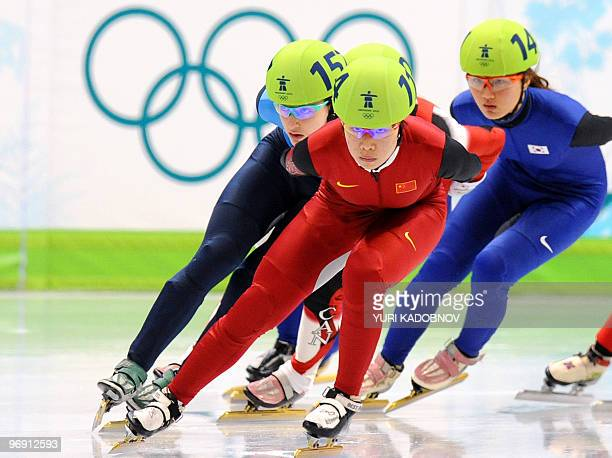 Gold medallist China's Yang Zhou competes with US' Katherine Reutter and South Korea's EunByul Lee in the Ladies' 1500m shorttrack final at the...