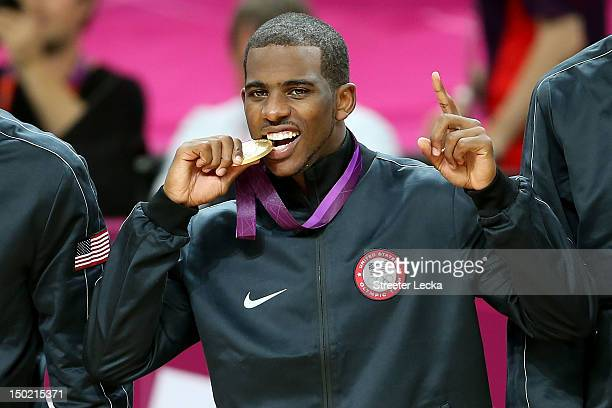 Gold medallist Chris Paul of the United States celebrates on the podium during the medal ceremony for the Men's Basketball on Day 16 of the London...