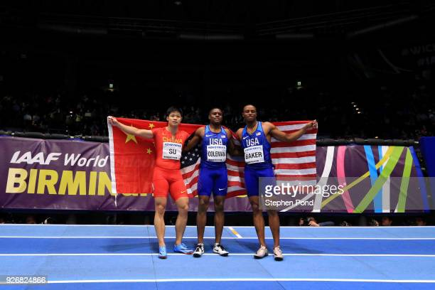 Gold Medallist Christian Coleman of United States Silver Medallist Bingtian Su of China and Silver Medallist Ronnie Baker of United States celebrate...