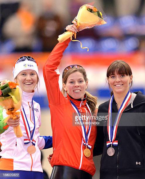 Gold medallist Christine Nesbitt of Canada silver medallist Heather Richardson of the US and bronze medallist Lotte van Beek of the Netherlands...