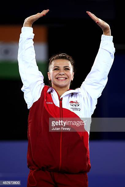 Gold medallist Claudia Fragapane of England celebrates during the medal ceremony for the Women's Vault Final during day eight of the Glasgow 2014...