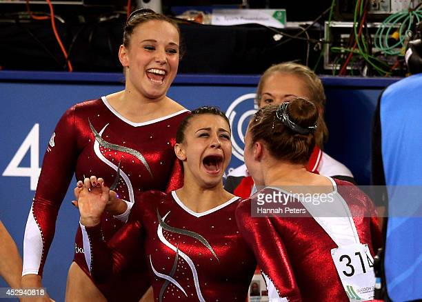 Gold medallist Claudia Fragapane of England celebrates with silver medallist Ruby Harrold of England and bronze medallist Hannah Whelan of England...