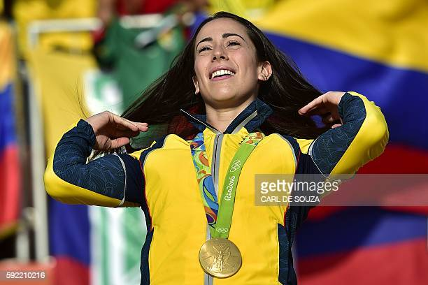 Gold medallist Colombia's Mariana Pajon celebrates on the podium of the women's BMX cycling event of the Rio 2016 Olympic Games at the Olympic BMX...