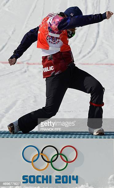 Gold Medallist Czech Republic's Eva Samkova celebrates during the Women's Snowboard Cross Flower Ceremony at the Rosa Khutor Extreme Park during the...