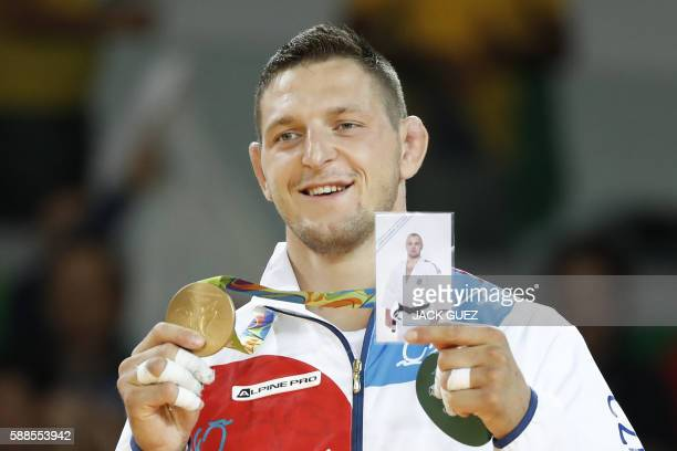 TOPSHOT Gold medallist Czech Republic's Lukas Krpalek celebrates on the podium of the men's 100kg judo contest of the Rio 2016 Olympic Games in Rio...