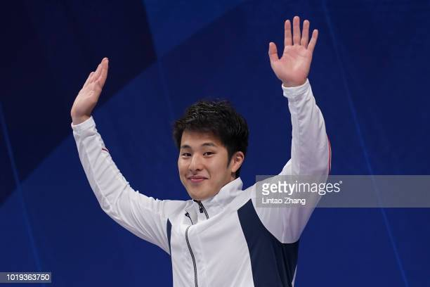 Gold medallist Daiya Seto of Japan celebrate during the victory ceremony of the men's 200m butterfly swimming event on day one of the Asian Games on...