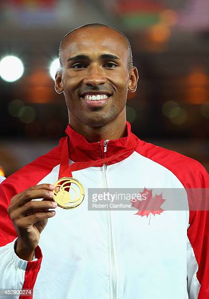 Gold medallist Damian Warner of Canada poses on the podium during the medal ceremony for the Men's Decathlon at Hampden Park during day six of the...