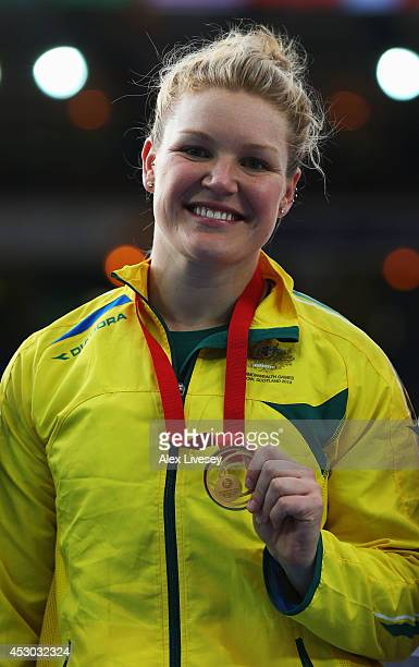 Gold medallist Dani Samuels of Australia poses on the podium during the medal ceremony for the Women's Discus Throw at Hampden Park during day nine...