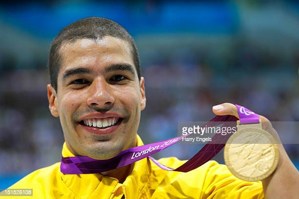 Gold medallist Daniel Dias of Brazil poses on the podium during the medal ceremony for the Men's 100m Freestyle S5 final on day 10 of the London 2012...