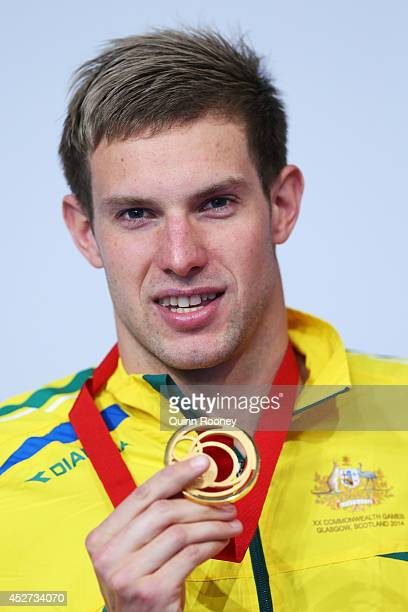Gold medallist Daniel Fox of Australia poses during the medal ceremony for the Men's 200m Freestyle S14 Final at Tollcross International Swimming...
