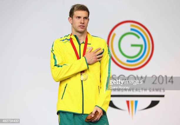 Gold medallist Daniel Fox of Australia stands on the podium during the medal ceremony for the Men's 200m Freestyle S14 Final at Tollcross...