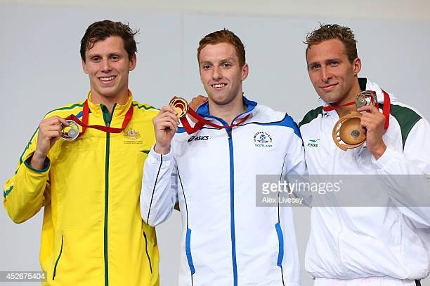 Gold medallist Daniel Wallace of Scotland poses with silver medallist Thomas FraserHolmes of Australia and bronze medallist Sebastien Rousseau of...