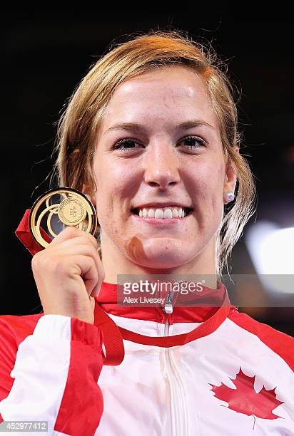 Gold medallist Danielle Lappage of Canada poses during the medal ceremony for the Women's FS 63 kg at Scottish Exhibition and Conference Centre...
