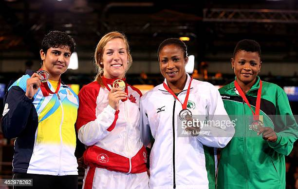 Gold medallist Danielle Lappage of Canada poses with silver medallist Geetika Jakhar of India and bronze medallists Blessing Oborududu of Nigeria and...